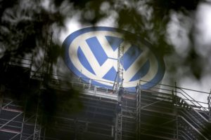 A Volkswagen logo stands on the roof of the company's headquaters in Wolfsburg, Germany October 7, 2015. Volkswagen Chief Executive Matthias Mueller said in an interview with a German newspaper that the company would launch a recall for cars affected by its diesel emissions crisis in January and complete the fix by the end of next year. REUTERS/Axel Schmidt